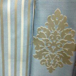 Компаньоны портьерная ткань голубая с вензелем и полоской